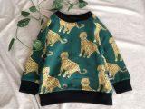 Donkergroene sweater met panters