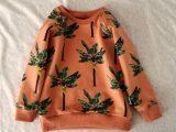 Amberbruine sweater met bananenpalmen